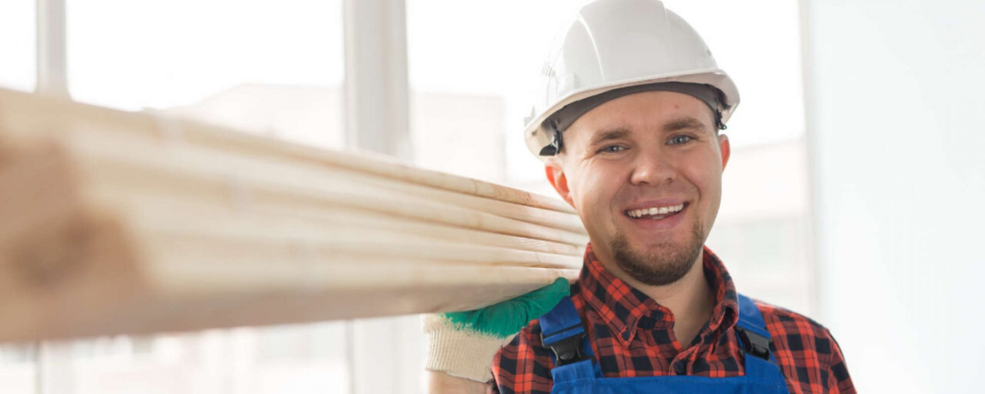 portrait-of-handsome-male-builder-laughing-infront-Q8N7DXV.jpg